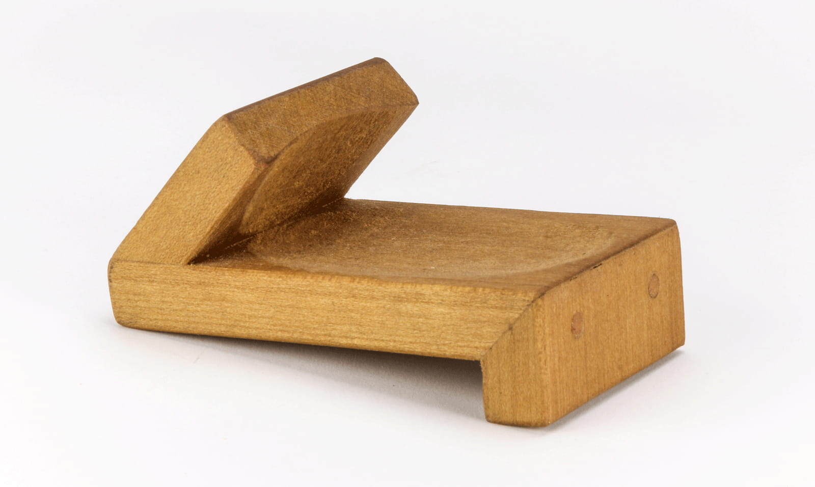 Wooden oyster holder helps support oyster for shucking