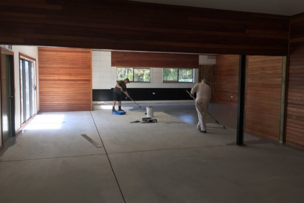 First coat going on the floor of the men's shed